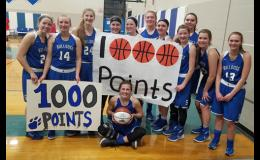 The lady Bulldogs made signs earlier in the week in preparation for Emily Beseman's (seated) career milestone.