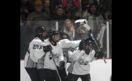 From left: Savannah Lowe, Allie Lemke, Megan Och, and Ally Ecker celebrate in front of a big student section following Ecker's third period goal against LDC last Thursday.