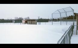 Snow drifts several feet high surround each dugout at the LPGE varsity softball field. The entire state of Minnesota has had to push back the spring sports season until warm weather comes and cleans up the wintry mess.