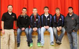 The Wolves bring back three of the four wrestlers who competed in the state tournament last season. Pictured L to R: head coach Jacob Lorentz, Noah Becker, Jadon Buntjer, Nicholas Middendorf, Creg Donabauer, and coach Travis Pesta.