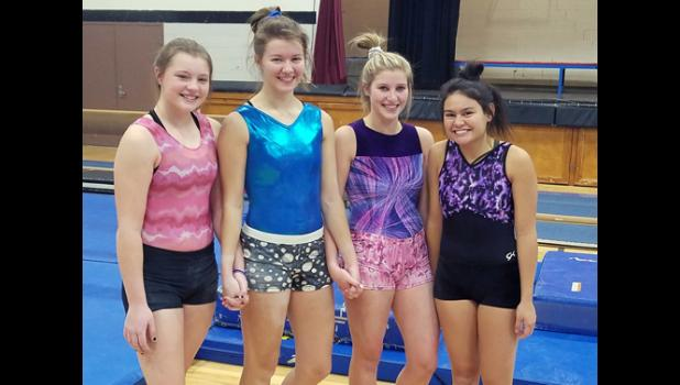 The Wolves bring back a solid core of seniors to lead the team this winter. From left: Tianna Larson, Emily Leroux, Tristen Marcyes, and Reanne Warwick.
