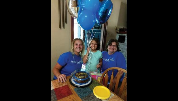 Cierra Kuehne of Long Prairie, center, was surprised by Make-A-Wish representatives Nicole and Bri, with a trip to Walt Disney World, Universal Studios and Sea World.