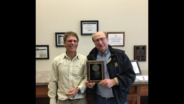Todd Soil, Water, Conservation and Development Director Tim Stieber, left, presented Todd County Parks and Trails Board Chair Al Loken with the 2016 Land Stewardship Award.