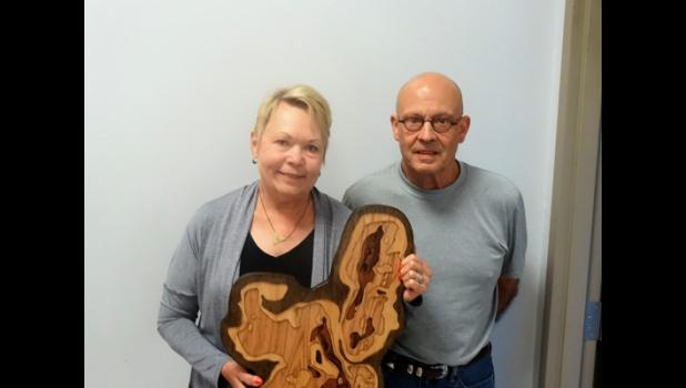 Tom and Laurie Fox receive award for native restoration.