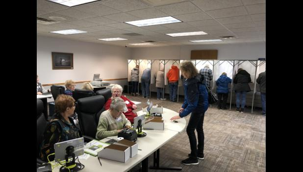 The polling station at the Long Prairie City Hall was a busy place yesterday as voters cast their ballots.