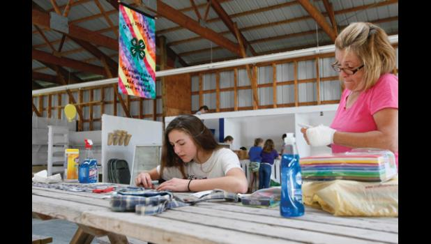 Members of the Todd County 4-H Clubs and their adult leaders gathered at the Todd County Fairgrounds last week to prep for this year's fair. The Todd County Fair starts this week.