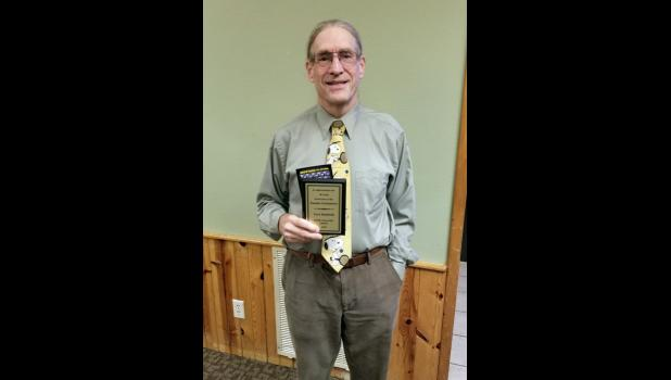 Longtime tennis coach Curt Hatfield was honored at last Wednesday's Prairie Conference banquet for his years of service to Long Prairie, Long Prairie-Grey Eagle, Swanville, and Upsala.