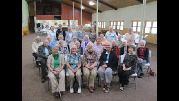 The Long Prairie Literary Club includes, in front, Fran Bokinskie, Gloria Ebacher, Dianne Flaten, Alice Siegle and Rogene Moss. Second row, Joan Dougherty, Marge Wall, Shirley Lano, Marge Morgan, Josie Terwey, Mary Terwey and Jane Schmid. Third row: Jan King, Donna Ostendorf, Phyliss Mosby, Pat Gray, Jane Bishop, Gloria Hebert and Sue Stine. In back, Marsha Paulsen, Dee Gjerstad, Jan Jorgensen, Annette Skiftun, Mary Borgheiinck, June Elmes and Linda Kielty. Photo Courtesy of the Dairyland Peach.
