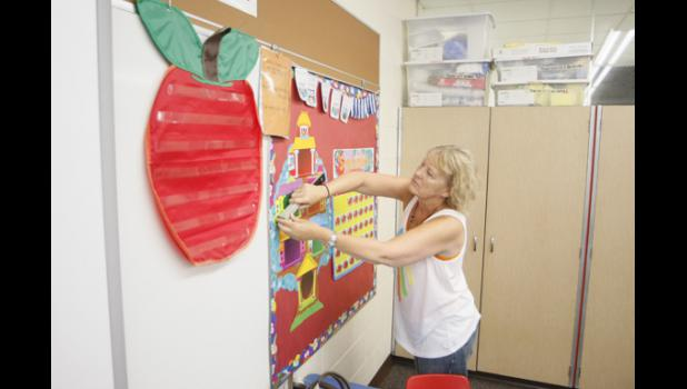 Jan Pederson readies her classroom at the LPGE Elementary School.