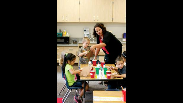 Kindergarten teacher Maressa Rousslange works with some students during the first day of school this year. This year there were three sections of Kindergarten at LPGE. Next school year there will be four.