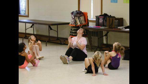 Youngsters in the Wee Ballet class work through a fun exercise.