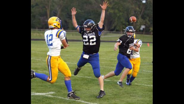 Matt Roe (22) got in the passing lane and Jack Mechels (23) covered a WDC receiver during a play in the second quarter.