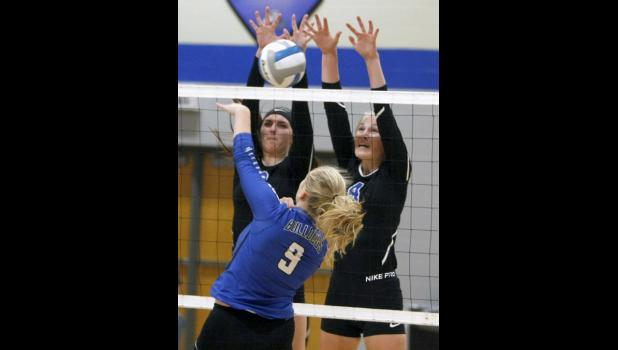 Thunder seniors Sahra Gugglberger (L) and Emma Liebsch (R) went up for a block against Swanville senior Hannah Schneider (9).