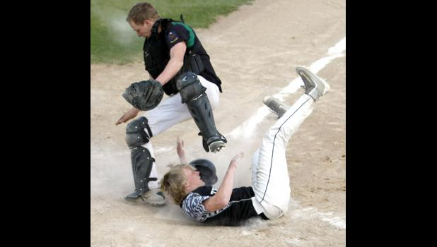 Matt Roe had to slide into home plate awkwardly to avoid getting hit by the catcher after a high throw to the plate.