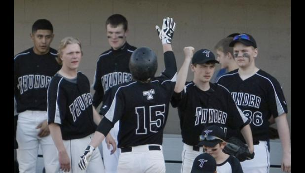 Sam Olson (15) celebrated with teammates after scoring a run in the later innings of the game against Upsala/Swanville Area.