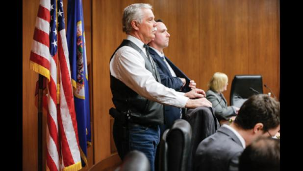Rep. Tony Cornish, chair of the House Public Safety and Security Policy and Finance Committee, waits — with a sidearm on his hip — to begin a March 8 hearing on two gun-related bills.  -Photo by Paul Battaglia, Minnesota House Information Services