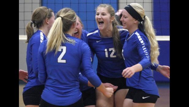 Swanville junior Avery Jackson (12) celebrates with her teammates after picking up a set win last Tuesday against LPGE.