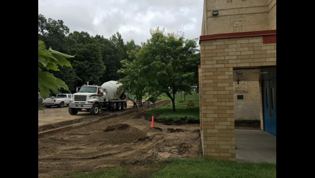 Road work and new sidewalks will hopefully eliminate flooding issues at the east entrance of the school building. The work is being done as part of the district's long-term facilities plan.