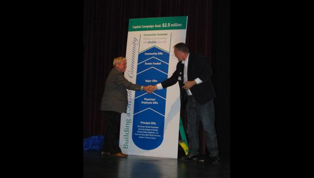 At left, Tom Sellnow, chair of CentraCare's capital campaign steering committee shakes hands with Duane Anderson from Farmer's Union Industries to kick off CentraCare's community campaign for a new medical campus.