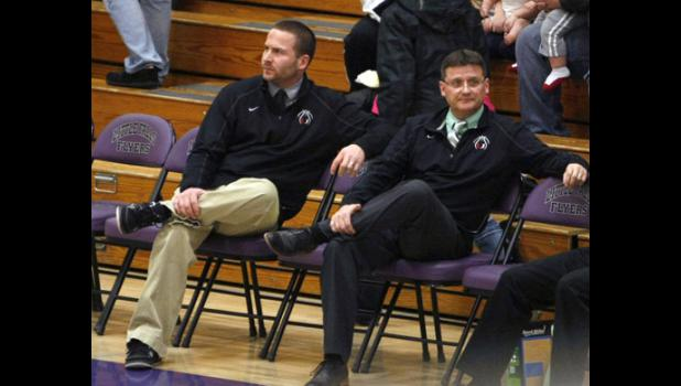 Joey Fuchs (L) and Vern Capelle (R) scout their opponents during warmups of a playoff game last season. Fuchs takes over for Capelle as head coach this year after playing for him for five years and being an assistant coach at Upsala for 10.