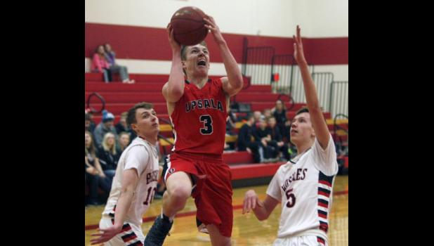 Upsala senior Bennett Westrich went up for a layup after splitting a pair of Isle defenders during last Tuesday's playoff game.
