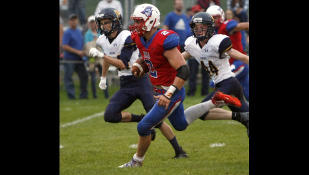 USA junior running back Michael Lange broke free into the Howard Lake-Waverly-Winsted secondary in the season opener. Lange finished with 211 yards and five touchdowns against the Lakers.