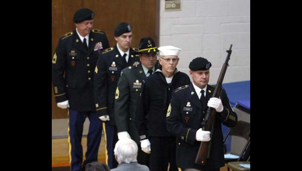 The Honor Guard members exit the stage after posting the colors.
