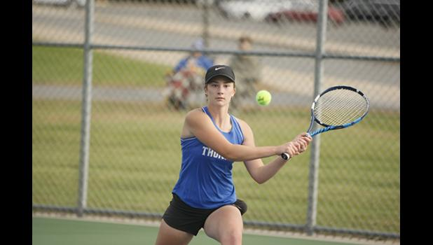 Abbi Larson returned a serve in her 2nd singles victory against Crosby Ironton Thursday.