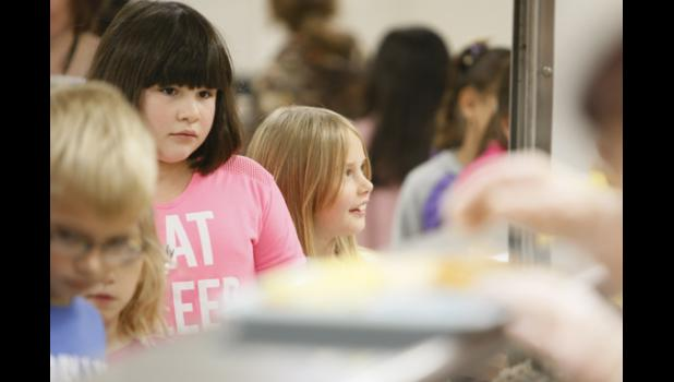 Long Prairie-Grey Eagle Elementary students check out the school lunch provided.