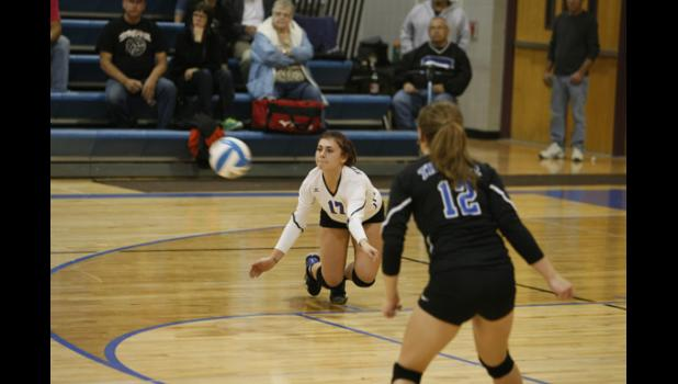 Senior libero Rachel Steward went down for a dig during the Thunder's match against Osakis last Tuesday.