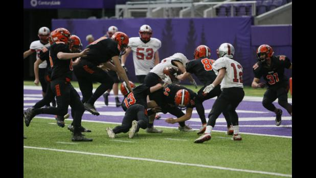 Sophomore Reis Irsfeld (13), Junior Aiden Eckel (44), and Senior Chris Vedbraaten (89) explemplified unselfish teamwork as they defended the goal line in the State Semifinal game Saturday, November 16.