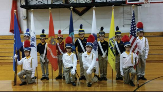 The USA Honor Squard includes, in front, from left, Cullen Lundeen, rifle guard and squad NCO, Nick Guthrie, squad executive officer, Kira Poppenhagen, squad commanding officer, Nick Dulas, rifle guard and squad officer. In back, from left, Xavier Stevens (USAF flag,) Quinn Guthrie (USCG flag,) Caleb Guthrie (USMC flag,) Desiree Kuhl (Navy flag,) Nolan Kuepers (Army flag,) Colton Kuhl (Gadsden flag,) and Dominic Eggert, assistant squad leader (U.S. Flag.)