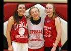 Sophomore Amber Biniek (L), senior Ashley Biniek (M), and eighth grader Kristine Biniek (R) have enjoyed the opportunity to all play on the varsity team together this season.