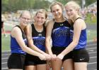 The 4x100 team stopped for a pre-race photo. From left: Kaitlyn Proell, Brianna Young, Nora Gamradt, and Megan Och.