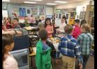 Students gather for breakfast in their classroom at the Long Prairie-Grey Eagle Elementary School.