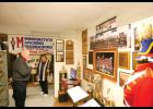Former music LPGE music instructor Orv Dahlen shows off the marching band exhibit. Dahlen, along with former marching band director Ray Gove, put together the exhibit for the historical society.