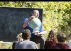 Above, Bertha-Hewitt science teacher Alan Hanson goes through a lesson with one of his eighth grade sections at the school's new outdoor classroom. The classroom was made possible by a grant with the Minnesota DNR.