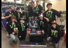 The Upsala robotics team includes: in back, from left, Mr. Curtis Robertson, Matt Tholl, John Sand, Parker Barth, Joshua Schlumpberger, Bailey Hayes, and Eric Staricka. In front, from left, Devon Butkowski, Isaiah Wardlaw, Isaac Guthrie, and Kennedy Allen.